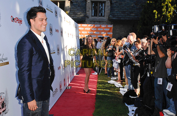 MICHAEL COPON .arriving at the Aces and Angels Celebrity Poker Tournament at the Playboy Mansion in the Holmby Hills of Los Angeles, California, USA, .July 11th 2009..half length necklace white shirt blue jacket side profile press pen .CAP/ROT.©Lee Roth/Roth Stock/Capital Pictures