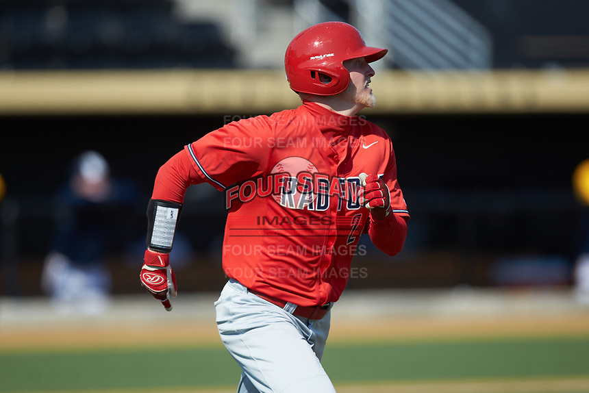 Adam Whitacre (24) of the Radford Highlanders hustles down the first base line against the Quinnipiac Bobcats at David F. Couch Ballpark on March 4, 2017 in Winston-Salem, North Carolina. The Highlanders defeated the Bobcats 4-0. (Brian Westerholt/Four Seam Images)