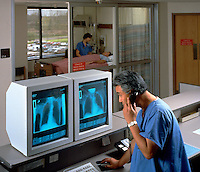 Interior view of a hospital and doctor looking at test results on a computer while talking on the phone.