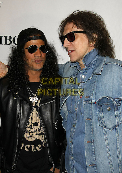 "SLASH & MICK ROCK .during the opening of Mick Rock's new exhibit, ""Rock N Roll Eye,"" at Symbolic Gallery, Las Vegas, Nevada, USA, .02 May 2008..half length denim jean jacket shirt sunglasses black leather jacket .CAP/ADM/MJT.©MJT/Admedia/Capital Pictures"