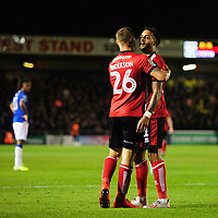 Lincoln City's Bruno Andrade, right, celebrates scoring his side's second goal with team-mate Harry Anderson<br /> <br /> Photographer Chris Vaughan/CameraSport<br /> <br /> The Carabao Cup Second Round - Lincoln City v Everton - Wednesday 28th August 2019 - Sincil Bank - Lincoln<br />  <br /> World Copyright © 2019 CameraSport. All rights reserved. 43 Linden Ave. Countesthorpe. Leicester. England. LE8 5PG - Tel: +44 (0) 116 277 4147 - admin@camerasport.com - www.camerasport.com
