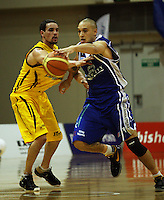 Saints guard Lindsay Tait gets past Josh Paurini during the NBL Round 9 match between the Wellington Saints and Nelson Giants at TSB Bank Arena, Wellington, New Zealand on Thursday 7 May 2009. Photo: Dave Lintott / lintottphoto.co.nz