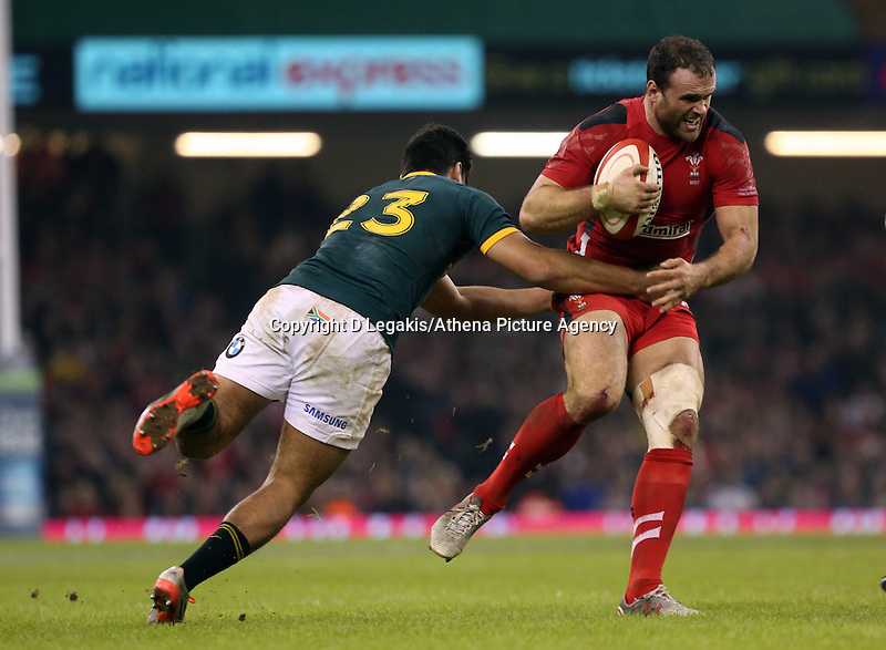 Pictured: Jamie Roberts of Wales is brought down by Damian de Allende away Saturday 29 November 2014<br />