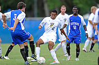 2 October 2011:  FIU forward Colby Burdette (2) battles Kentucky defender Pedro Andreoni (3) for the ball in the second half as the FIU Golden Panthers defeated the University of Kentucky Wildcats, 1-0 in overtime, at University Park Stadium in Miami, Florida.