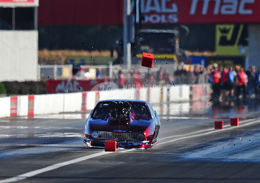 Sept. 4, 2010; Clermont, IN, USA; NHRA pro mod driver Roger Burgess hits the timing blocks during qualifying for the U.S. Nationals at O'Reilly Raceway Park at Indianapolis. Mandatory Credit: Mark J. Rebilas-