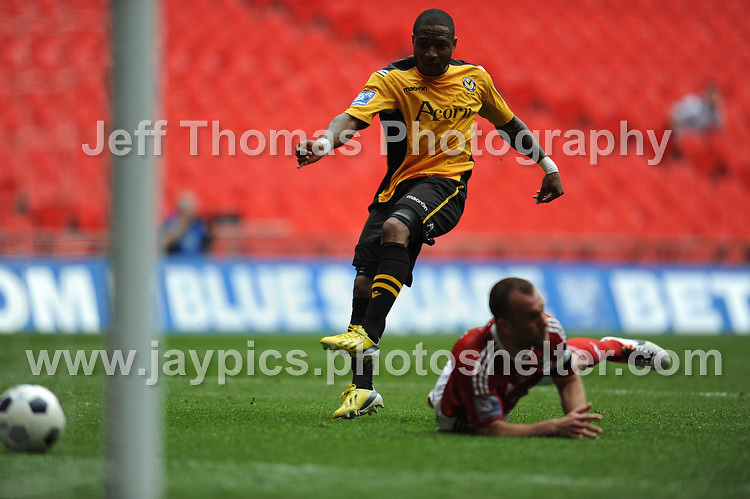Newports Aaron O'Connor scores his sides second goal during the Newport County v Wrexham Blue Sq. Bet Premier league playoff final at Wembley Stadium, London, England Sunday 5th May 2013. Credit for pictures to Jeff Thomas Photography - www.jaypics.photoshelter.com - 07837 386244 - Use of images are restricted without prior permission of the copyright owner Jeff Thomas Photography.
