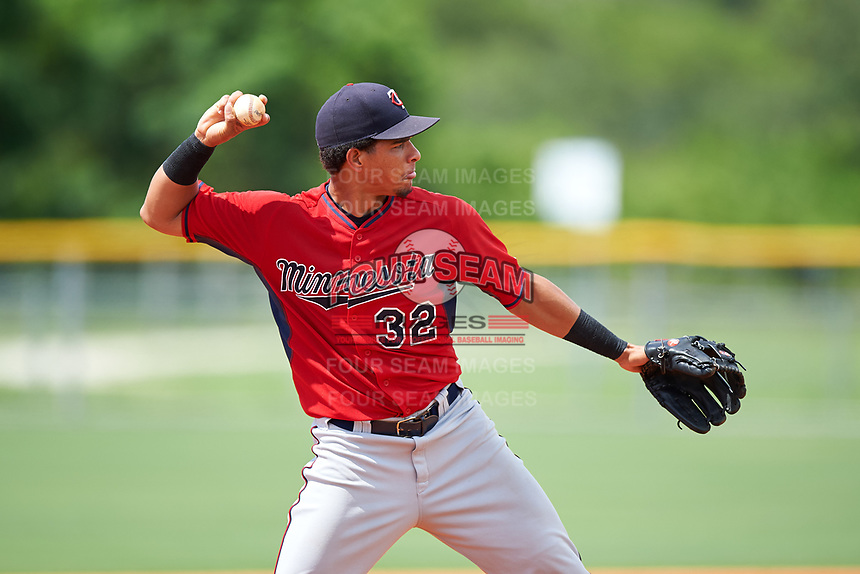 GCL Twins third baseman Roni Tapia (32) throws during the first game of a doubleheader against the GCL Rays on July 18, 2017 at Charlotte Sports Park in Port Charlotte, Florida.  GCL Twins defeated the GCL Rays 11-5 in a continuation of a game that was suspended on July 17th at CenturyLink Sports Complex in Fort Myers, Florida due to inclement weather.  (Mike Janes/Four Seam Images)