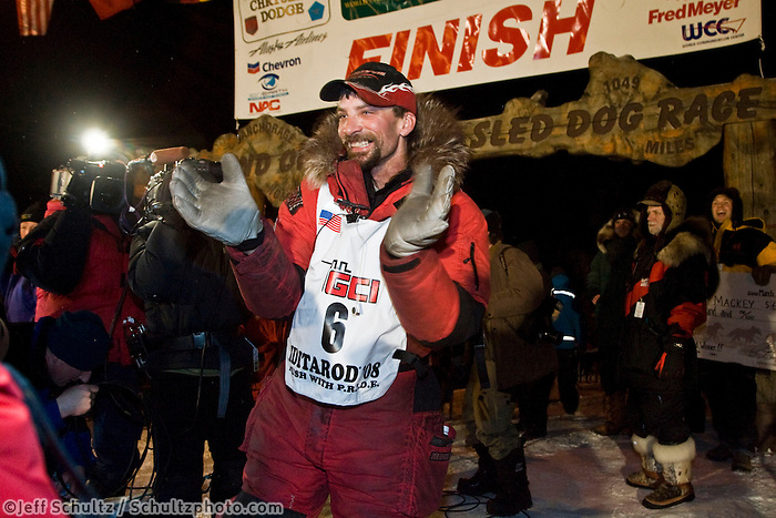 Race fans line the finish chute as Lance Mackey wins the 2008 Iditarod
