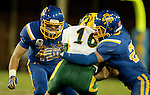BROOKINGS, SD - OCTOBER 3:  Nick Mears #42 and Jimmy Forsythe #25 from South Dakota State bring down RJ Urzendowski #16 from North Dakota State in the second quarter of their game Saturday night at Coughlin Alumni Stadium in Brookings. (Photo by Dave Eggen/Inertia)