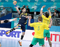 Spain's Antonio Garcia Robledo (l) and Australia's Tommy Fletcher (c) and Martin Najdovski during 23rd Men's Handball World Championship preliminary round match.January 15,2013. (ALTERPHOTOS/Acero) /NortePhoto