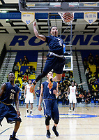 """Hylton's Will Norwood dunks during the 6A Region semifinals at Robinson H.S. in Fairfax. Norwood """"played his best game ever,"""" according to his coach, Barry Smith."""