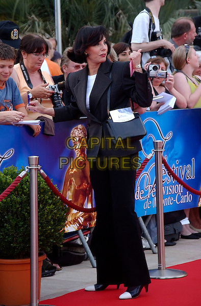 DENISE FABRE.Arrivals at the 48th Monte Carlo Television Festival on June 8, 2008 in Monaco, Monte Carlo. .June 8th, 2008.full length black trousers jacket looking over shoulder suit fans crowd .CAP/TTL.© TTL/Capital Pictures