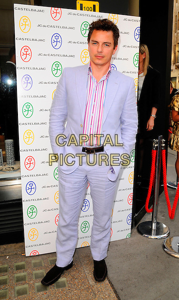 JOHN BARROWMAN.The JC de Castelbajac London flagship store launch, 50/51 Conduit St., London, England..June 5th, 2008.JC/DC JC / DC full length suit blue purple striped stripes shirt hands in pockets .CAP/CAN.©Can Nguyen/Capital Pictures.