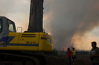 Burning a sugar cane field in Escuintla, Guatemala on Wednesday, March 20, 2007.