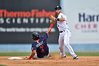 Asheville Tourists shortstop Taylor Snyder (28) makes the turn on a double play over hard charging Lucas Herbert (7) during a game against the Rome Braves at McCormick Field on July 30, 2017 in Asheville, North Carolina. The Braves defeated the Tourists 7-3. (Tony Farlow/Four Seam Images)