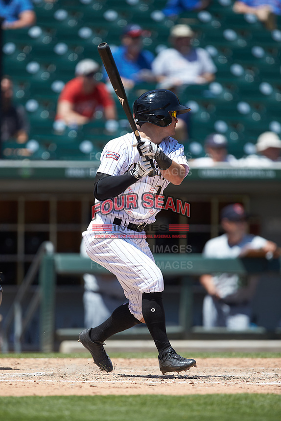 Eddy Alvarez (10) of the Charlotte Knights follows through on his swing against the Gwinnett Stripers at BB&T BallPark on May 2, 2018 in Charlotte, North Carolina.  The Knights defeated the Stripers 6-5.  (Brian Westerholt/Four Seam Images)