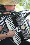 May 25, 2008. Carrboro...Jil Christensen plays accordian for the sunday brunch crowd at Weaver Street Market on Sunday, May 25th, 2008 in Carrboro...