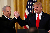 United States President Donald J. Trump shake hands with Israel's Prime Minister Benjamin Netanyahu during a meeting in the East Room of the White House in Washington, D.C.,on Tuesday, January 28, 2020. Credit: Joshua Lott / CNP