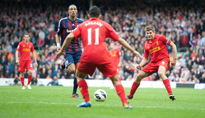 Liverpool's Steven Gerrard completes a pass to team-mate Luis Suarez ..Football - Barclays Premiership - Liverpool v Stoke City - Sunday 7th October 2012 - Anfield - Liverpool..