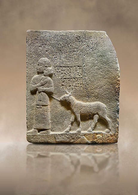 """Photo of Hittite monumental relief sculpted orthostat stone panel of Royal Buttress. Basalt, Karkamıs, (Kargamıs), Carchemish (Karkemish), 900-700 B.C. Anatolian Civilisations Museum, Ankara, Turkey<br /> <br /> The queen carries her youngest son. The hieroglyphs located above read; """"and this is Tuwarsais; the prince desired by the ruler, whose exclusiveness has been exposed"""". While the queen carries her son in her lap, she holds the rope of the colt coming behind with her other hand. The muscles of the colt are schematic. <br /> <br /> Against a brown art background."""