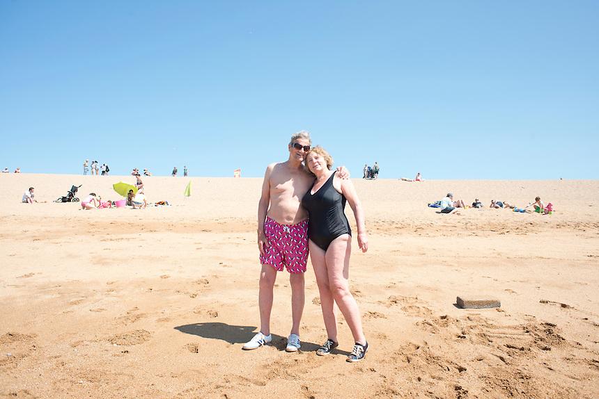 My parents Sarah and John Wiseman at the beach. Summer day at West Bay, Brid Port, Dorset, UK.