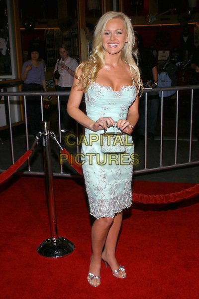 "KATIE LOHMANN.The Premiere of ""Meet The Fockers"" to benefit the American Film Institute held at Universal Amphitheatre, Hollywood, California..December 16th, 2004.full length, blue dress, little blue purse, bag, cleavage.www.capitalpictures.com.sales@capitalpictures.com.© Capital Pictures."