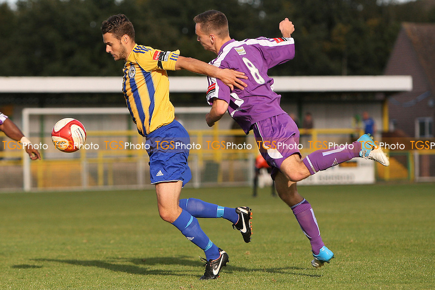 Paul Clayton of Romford tangles with Jack Woodward of Thurrock - Romford vs Thurrock - FA Challenge Trophy 1st Round Football at Ship Lane, Thurrock FC - 29/09/12 - MANDATORY CREDIT: Gavin Ellis/TGSPHOTO - Self billing applies where appropriate - 0845 094 6026 - contact@tgsphoto.co.uk - NO UNPAID USE.