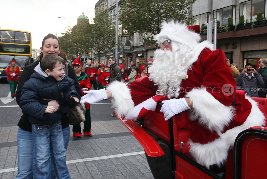 ****NO FEE PIC ******.19/11/2011.Santa Claus greets Tadgh McCormac (5) from tallaght during a Christmas Parade.at the opening of Santa's Playland in The Ambassador Theatre,Dublin.One of this Christmas' biggest events is coming!  Santa's Playland takes up residence at The Ambassador Theatre in preparation for this year's festive season.  The spectacular event opens on Saturday 19 November and runs until Friday 23 December. Santa's Playland will see children transported to a magical Christmas paradise.On entering Santa's Playland children will be treated to a special Christmas play time.  The Play Area is full of Christmas treats with bouncy castles, slides and Christmas displays..Photo: Gareth Chaney Collins