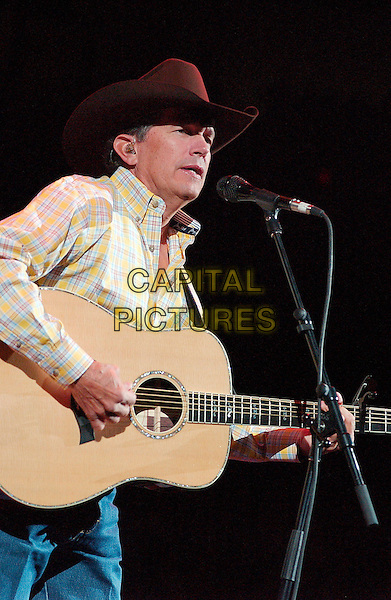 GEORGE STRAIT.Country music star GEORGE STRAIT performs as a part of his 2007 Tour held at the Mellon Arena, Pittsburgh, Pennsylvania , USA, 16 February 2007..half length guitar cowboy hat concert live on stage.CAP/ADM/JN.©Jason L Nelson/AdMedia/Capital Pictures.