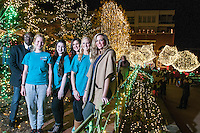 NWA Democrat-Gazette/ANTHONY REYES • @NWATONYR<br /> Godwin-Charles Ogbeide, (from left) hospitality professor for the University of Arkansas, with hospitality students Rosa Weinhold, Lauren Simpson, Melanie Grubb, Allie Coss, and Ashley Byrd, graduate assistant, Wednesday, Dec. 9, 2015 on the Fayetteville square. Hospitality students organized the opening ceremony for the Lights of the Ozarks.