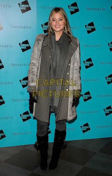 HOLLY VALANCE .At the Somerset House Ice Rink VIP Opening, Somerset House, The Strand, London, England, UK, .November 22nd 2010..full length black coat grey gray scarf fur black knee high boots gloves jeans .CAP/CAN.©Can Nguyen/Capital Pictures.