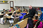 Oct. 4, 2013; Rev. Timothy Scully, C.S.C. chats with fourth grade students at St. Rita School in Ft. Worth, TX.  The Alliance For Catholic Education (ACE) kicked off its Fighting For Our Children's Future National Bus Tour during the Shamrock Series events in Dallas and Fort Worth.<br /> <br /> Photo by Matt Cashore/University of Notre Dame
