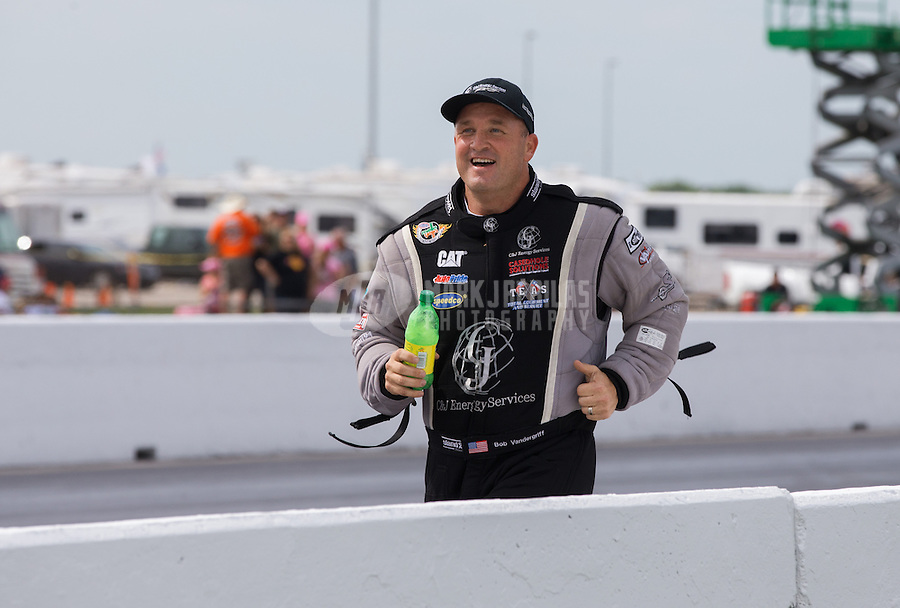 Apr. 28, 2013; Baytown, TX, USA: NHRA top fuel dragster driver Bob Vandergriff Jr runs up the track as he celebrates after winning the Spring Nationals at Royal Purple Raceway. Mandatory Credit: Mark J. Rebilas-