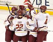 Edwin Shea (BC - 8), Paul Carey (BC - 22), Pat Mullane (BC - 11), Johnny Gaudreau (BC - 13) and Tommy Cross (BC - 4) celebrate Mullane's goal which gave BC a 1-0 lead late in the second period. - The Boston College Eagles defeated the visiting University of Massachusetts-Amherst Minutemen 2-1 in the opening game of their 2012 Hockey East quarterfinal matchup on Friday, March 9, 2012, at Kelley Rink at Conte Forum in Chestnut Hill, Massachusetts.