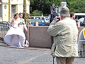 St. Petersburg, Russia - August 15, 2009 -- An unidentified man photographs one of the many wedding parties on a warm Saturday afternoon in St. Petersburg, Russia on Saturday, August 15, 2009..Credit: Ron Sachs / CNP