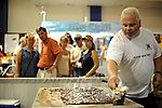 A man makes fudge inside the Cream Puff Pavilion at the Wisconsin State Fair in West Allis, Wisconsin on August 3, 2008.