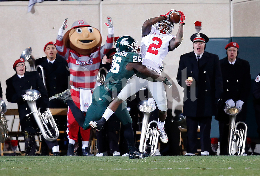 Ohio State Buckeyes running back Dontre Wilson (2) catches a touchdown pass under pressure from Michigan State Spartans safety RJ Williamson (26) in the fourth quarter of the college football game between the Ohio State Buckeyes and the Michigan State Spartans at Spartan Stadium in East Lansing, Saturday night, November 8, 2014. (The Columbus Dispatch / Eamon Queeney)