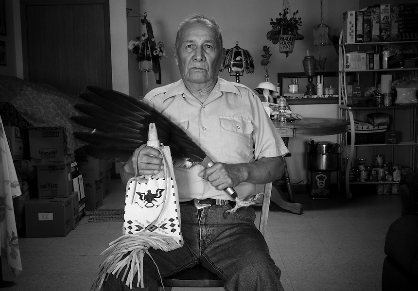 Pete Plenty Wounds, chief of the Lakota Red Feather Society .He is holding a daily pipe and a fan from eagle feathers, symbol of social status. The Society has only 11 members because of the hard 10 step initiation the candidates must pass before becoming members. Pete Plenty Wounds revealed only the first step, a very painful piercing ceremony..