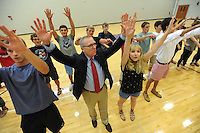NWA Democrat-Gazette/ANDY SHUPE<br /> Jeff Long (center), athletics director at the University of Arkansas, calls the Hogs Wednesday, Sept. 2, 2015, after speaking to a group of juniors at Fayetteville High School. Long spoke during students' seventh-period advisory period about his career as a student, as a coach and athletics director, encouraging students to pursue their dreams and their education.