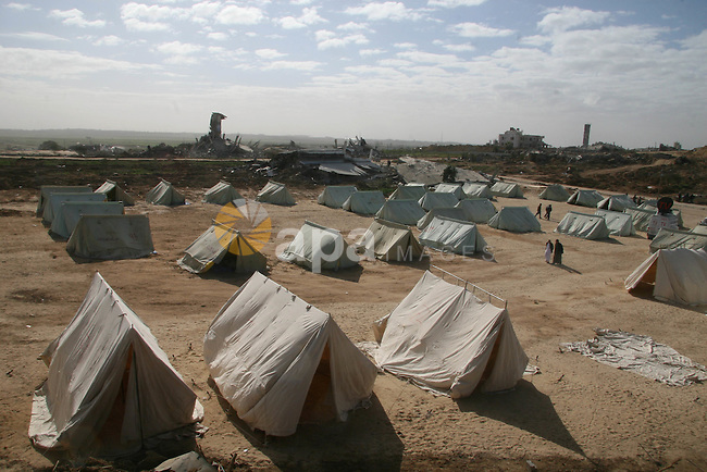 A Palestinian man walks among tents erected to house those who lost their homes during the 22-day Israeli offensive in Jabalia in the northern Gaza Strip on January 31, 2009. A rocket fired by Palestinian militants from the Gaza Strip exploded in southern Israel, but there were no casualties or damage reported, the Israeli army said. It is the third rocket attack since ceasefires on January 18 brought an end to Israel's three-week onslaught against Gaza which left more than 1,330 Palestinians dead.  APAIMAGES PHOTO / Ashraf Amra