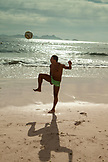 BRAZIL, Rio de Janiero, a man juggling a soccer ball on Copacabana Beach