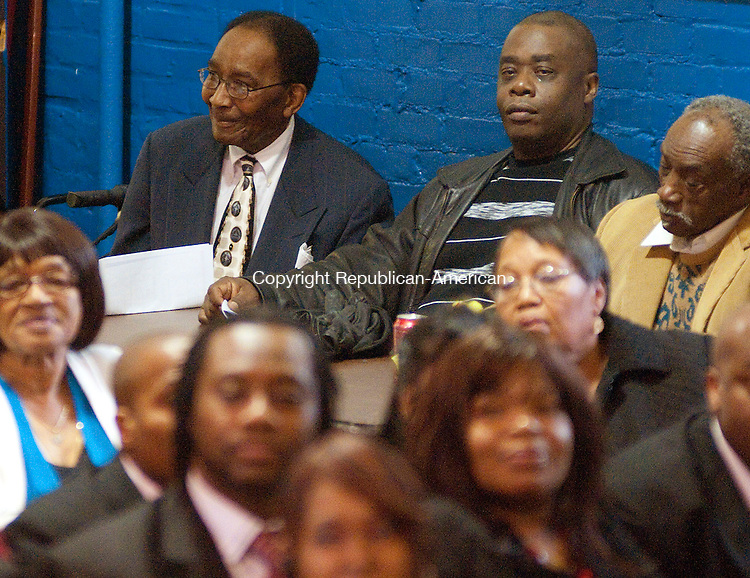 WATERBURY, CT, 20 MARCH 2011-032011JS07--Local gospel music promoter William &quot;Archie&quot; Davis, left, listens to gospel music from Spiritual Souls of Waterbury during a celebration in his honor for his years of promoting gospel musicians Sunday at the Hopkins Street Center in Waterbury. <br /> Jim Shannon/Republican-American