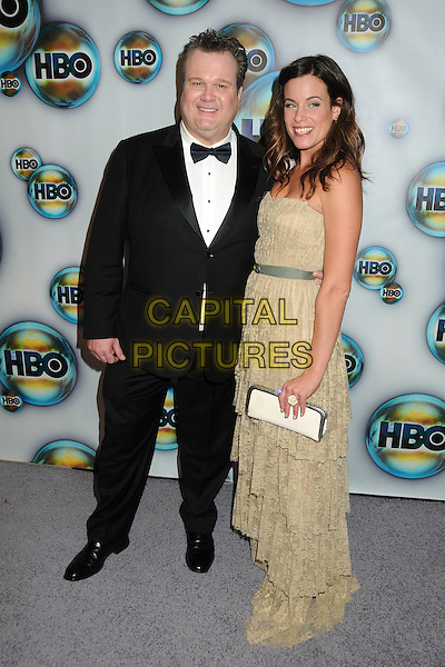 Eric Stonestreet & Catherine Tokarz.HBO 2012 Golden Globe Awards Post Party held at Circa 55 Restaurant, Beverly Hills, California, USA..January 15th, 2012.full length black tuxedo white shirt bow tie beige dress couple .CAP/ADM/BP.©Byron Purvis/AdMedia/Capital Pictures.