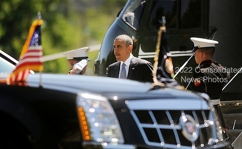 United States President Barack Obama arrives at Walter Reed National Military Medical Center to visit with Wounded Warriors June 4 , 2013 in Bethesda, Maryland. <br /> Credit: Olivier Douliery / Pool via CNP