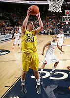CHARLOTTESVILLE, VA- NOVEMBER 29: Evan Smotrycz #23 of the Michigan Wolverines grabs a rebound during the game on November 29, 2011 at the John Paul Jones Arena in Charlottesville, Virginia. Virginia defeated Michigan 70-58. (Photo by Andrew Shurtleff/Getty Images) *** Local Caption *** Evan Smotrycz
