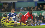 Maarten Stekelenburg of Everton is injured after clashing with Leighton Baines of Everton and Sadio Mané of Liverpool during the English Premier League match at Goodison Park, Liverpool. Picture date: December 19th, 2016. Photo credit should read: Lynne Cameron/Sportimage