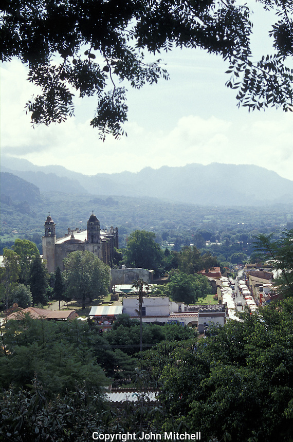 View of the Spanish colonial town of Tepoztlan, Morelos, Mexico. Tepoztlan is built on the ruins of an ancient Aztec city said to be the birthplace of the Aztec god Quetzalcoatl. Tepoztlan has been designated a pueblo magico or magical town. The 16th-century Ex-Convento Dominico de la Natavidad that dominates Tepoztlan's skyline is a UNESCO World Heritage Site.