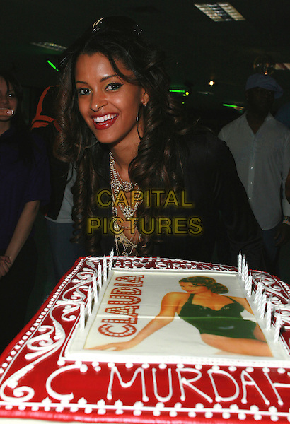 CLAUDIA JORDAN & CARL PAYNE.At Claudia Jordan's Birthday Party held at Skateland, Northridge, California, USA, 12 April 2007..half length cake.CAP/ADM/CH.©Charles Harris/AdMedia/Capital Pictures.