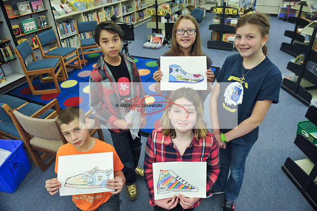 From top left, Eagle River Elementary sixth grade art students Branden Wetzel, Cora Kallen,  Meredith Whalen and from bottom row, Isaac Depoe and Grace Hardy pose in the Eagle River Elementary library.  Photo for the Star by Michael Dinneen