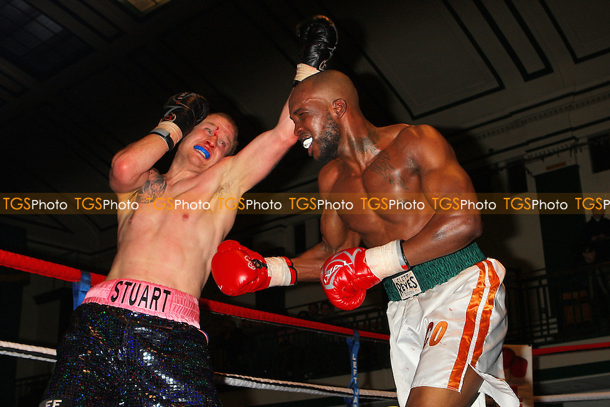 Scott Hartley (pink/blue shorts) defeats Marco Stephenson in a Super-Middleweight boxing contest at York Hall, Bethnal Green, promoted by Left Jab - 04/03/11 - MANDATORY CREDIT: Gavin Ellis/TGSPHOTO - Self billing applies where appropriate - 0845 094 6026 - contact@tgsphoto.co.uk - NO UNPAID USE.
